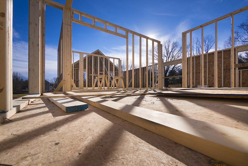 Wooden beams of a house being constructed seen while providing home inspection services