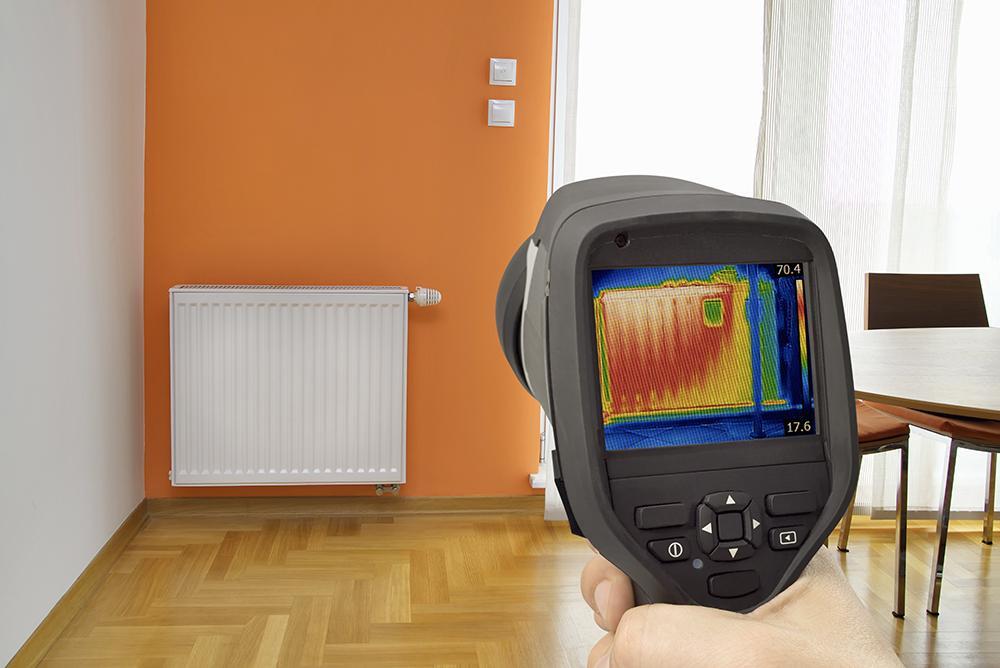 Thermal imaging camera pointed at a radiator by one of our home inspectors